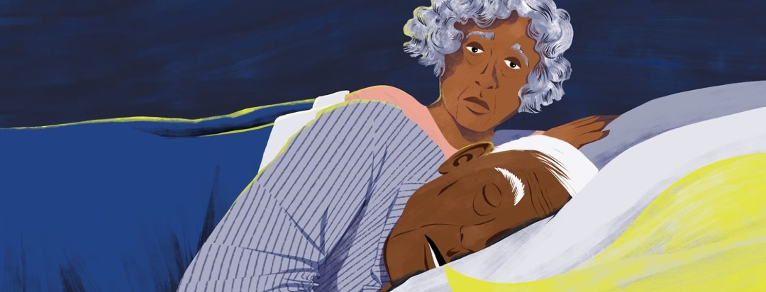 An elderly couple is in bed, the man is fast asleep and snoring and the woman is awake and looking concerned over his shoulder