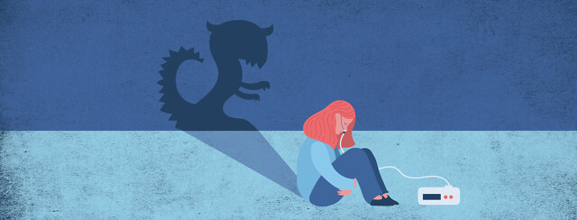A woman with an CPAP machine sitting on the floor hugging knees with her head bowed, casting a monster shaped shadow